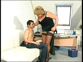 Blonde granny in stockings turns on a..