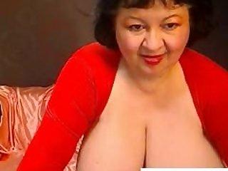 Busty Russian Granny strips